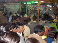 Inside gathering of pilgrims in exhibition Vasant Panchami