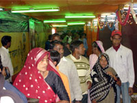 Inside gathering of pilgrims in exhibition Mauni Amavsya